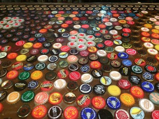 Resin beer cap bar top picture of tapcade kansas city for Beer cap bar top