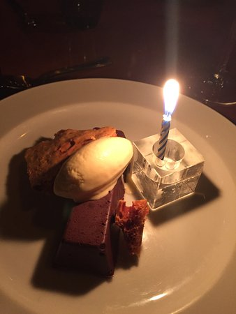 "Cafe Brio : The ""birthday"" candle on my choclate tart with sponge toffee and creme fraiche ice cream"