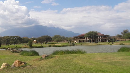 The Kilimanjaro Golf and Wildlife Estate: 9th Hole with Club House and Mount Meru as a backdrop