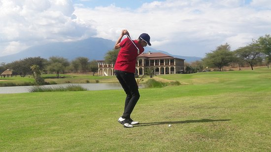 The Kilimanjaro Golf and Wildlife Estate: Practice chip with the 9th iron for the 9th hole