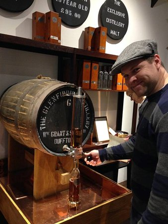 Dufftown, UK: A happy man, bottling his own whiskey!