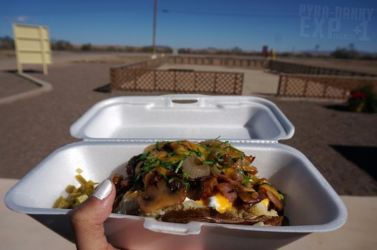Alpine, TX: Texas Tater - mine has Mushrooms, Broccoli, Jalapenos, Cheese, Sour Cream, Chives, Cilantro... u