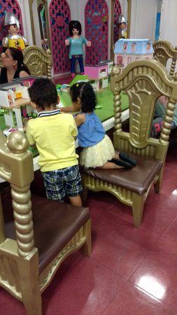 PLAYMOBIL FunPark: This table with dollhouses was hard to get a seat at, love the seats btw.