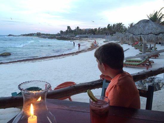 Watching fisherman line fish while waiting for dinner at Zamas