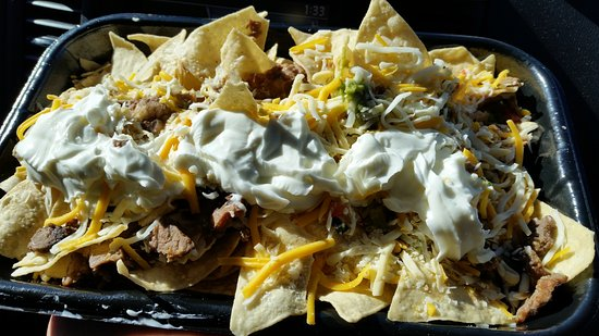 Mustang, OK: Wrong, steakhouse nachos with frozen steak on it.