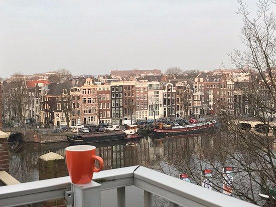 The Bridge Hotel: morning coffee on balcony over Amstel