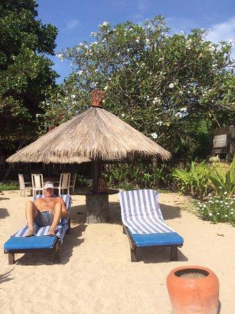 Matahari Terbit Bali Deluxe Bungalows: Sun beds on beach ❤️Plus just watch water sports