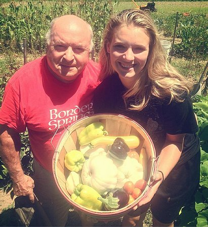 Clifton Forge, VA: Chef Michel Galand and his granddaughter, Kirsten Holley gathering vegetables from Chef's garden