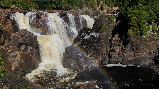 Fort Coulonge, Canada: Rainbows that form above the sunlit spray of water