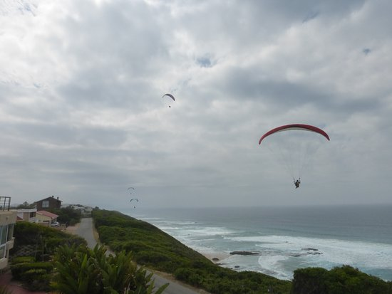 "Shining Waters: Being on terrace you are ""eye-to-eye"" with paragliders & sea-gulls...."