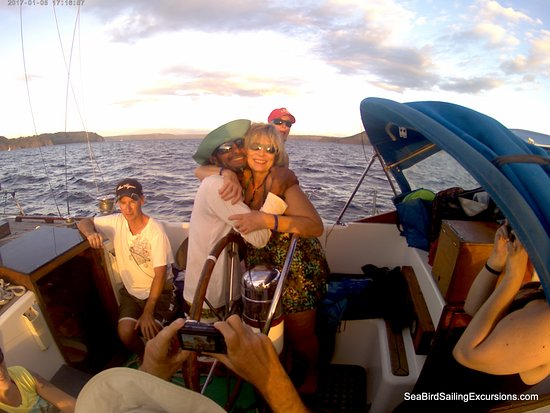 Sea Bird Sailing Excursions: A birthday hug from Sebastian, who's wearing my rescued hat...