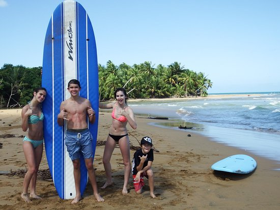 East Island Surfing Adventures: My kids and the instructor's awesome son.