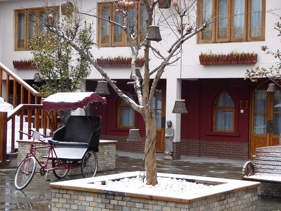 First Snow Day In Beijing At Red Wall Garden Hotel