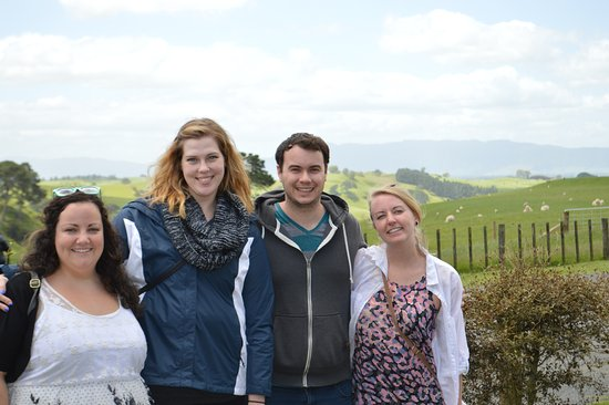 Love My New Zealand: Photo at Hobbiton. Sharon and team take photos of the group for you!