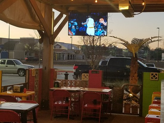 Greenville, TX: Several televisions throughout restaurant. Out door patio even has 2 large televisions