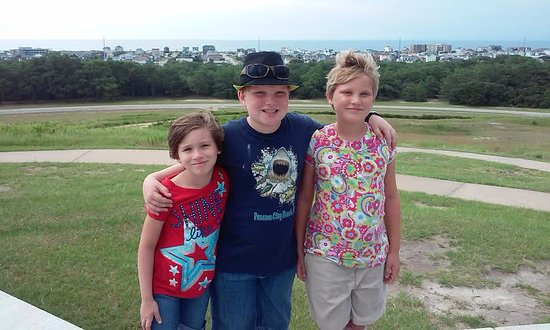 Kill Devil Hills, NC: At the top of the hill with the ocean behind.
