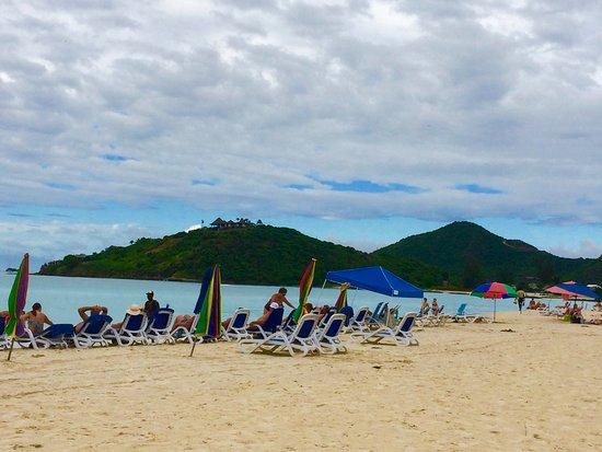 Saint Mary Parish, Antigua: Umbrellas and Sunbeds area to immediate right of beach