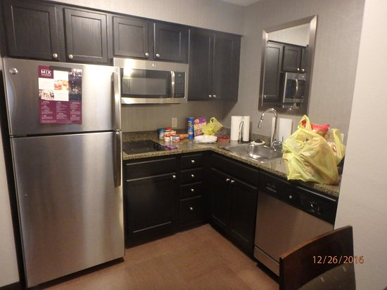Franklin, MA: the kitchen area, with full sized fridge and stove- no oven, but microwave.