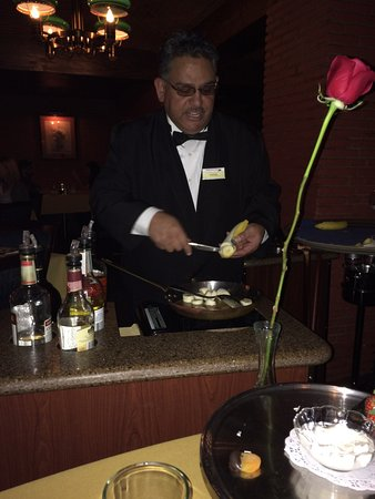 Hugo's Cellar: The waiter creates the desert at table side in elegance and old Style