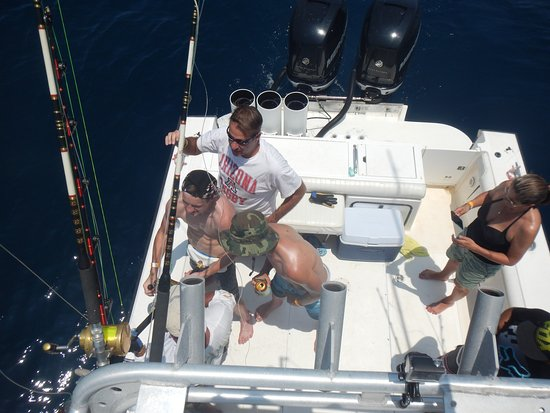 Boca Chica, Panama: Reeling in a huge Sailfish with the Rogers family from California.