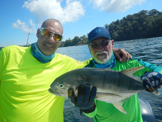 Boca Chica, Panama: Two happy fishermen with a Jack Crevalle- yum