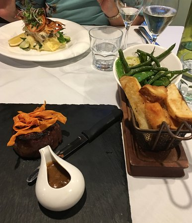 Dicky Beach, Australia: Lower Dish is 200gm Steak, beans, sprouts and Chunky Cut Chips. Top Dish is Barrumundi