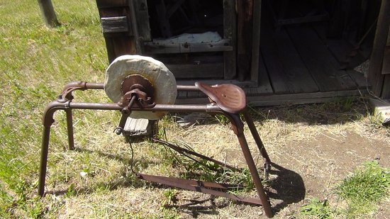 Oroville, WA: antique grinding wheel at Old Molson