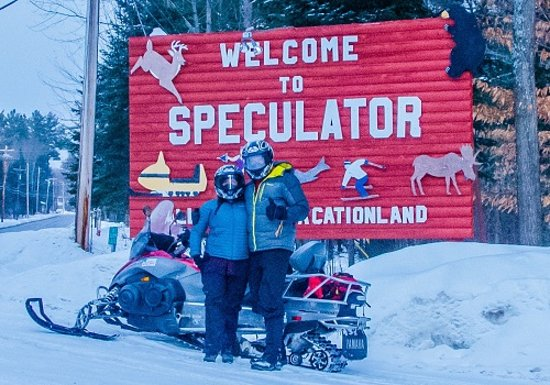 Snowmobiling in Speculator with a sled from Village Rentals!