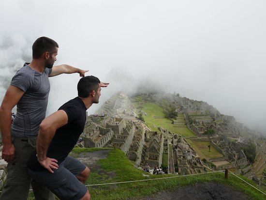 quotlook over there machu picchu emerging from the clouds