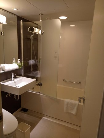 bathtub has glass door that is good , preventing water to go all ...