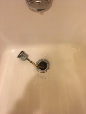 Hilton Boston Logan Airport: This doesn't look good!   And what is really gross is the hair protruding from the drain!