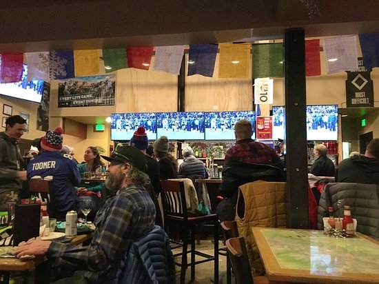 Teton Village, WY: Bank of TV's above the bar perfect for viewing your favorite teams… Played ski movie after the g
