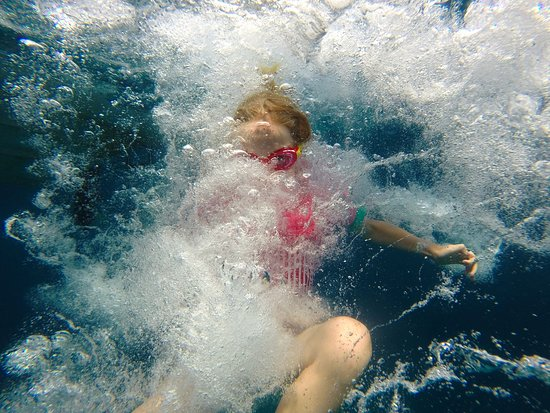 Le Sentier du Littoral, Cap d'Antibes : The kids loved jumping off the boat to find fish