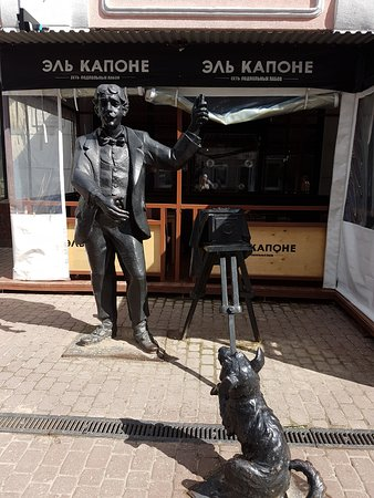Sculpture Photographer with Dog