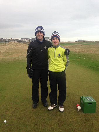 Sam Murphy with Carnoustie Pro Colin Sinclair on the 18th tee