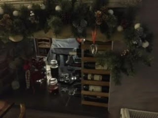 Llanllwni, UK: Belle Vue Inn - section of the restaurant with selection of wines among the Christmas decoration