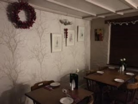 Llanllwni, UK: Belle Vue Inn - section of the restaurant with Christmas decorations