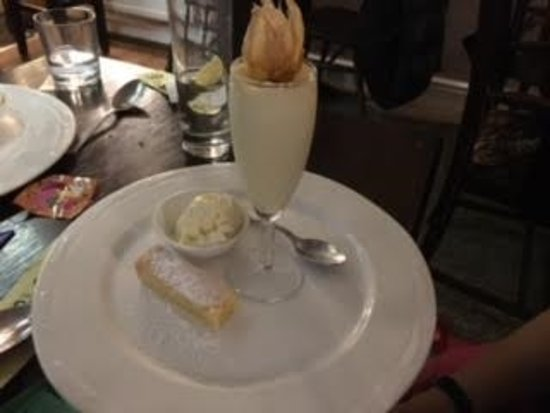 Llanllwni, UK: Belle Vue Inn - the dessert of orange and Grand Marnier panna cotta with gluten free shortbread