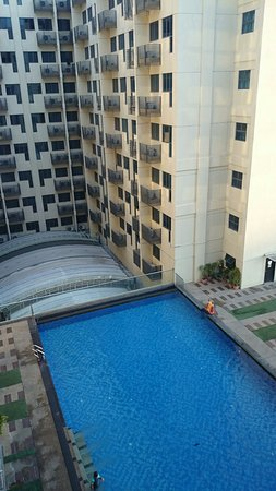 The swimming pool photo from the room it looks nice but not clean ming garden hotel for Public swimming pools in ajman