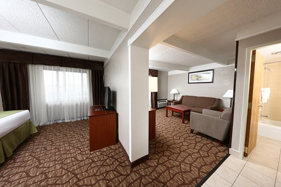 Best Western Hospitality Hotel & Suites: Our king suite has 2 TV's and a sitting area in the other room.