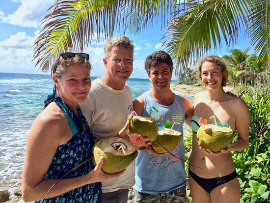 Off The Wall Dive Center & Resort: Fresh coconut water with local rum, perfect family afternoon
