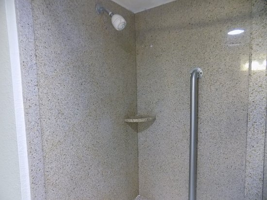 Comfort Inn : New shower enclosure surrounding the OLD tub.
