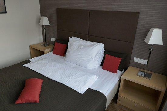 Alwyn : Bed in my room.