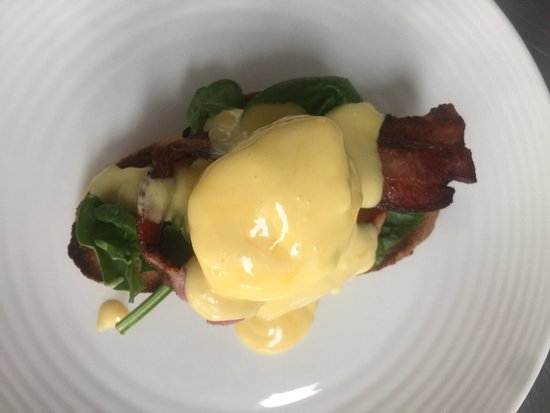 Karuah, Australia: Our beautiful Eggs Benny shown here as one half of a serve divided up for two customers.  A time