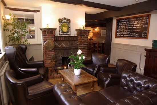 White lion pub: The cosy fireplace area and specials board