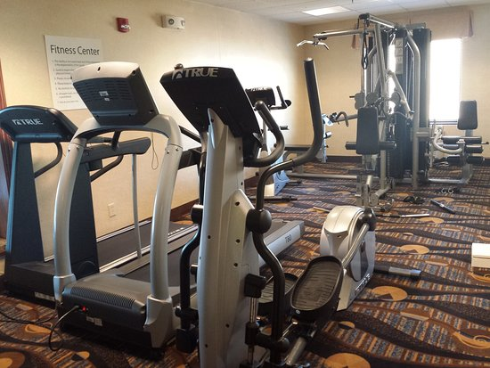 Concordia, KS: Fitness center with elliptical, treadmill and weight machine.