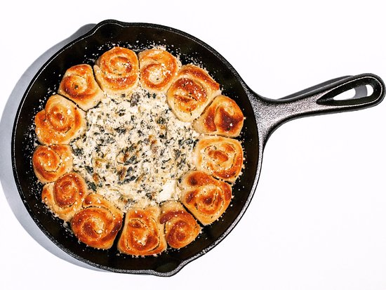 Nixa, MO: Spin Dip Skillet | Creamy, cheesy spinach dip surrounded by garlic-butter bread knots.