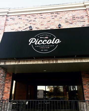 Piccolo has the best covered patio in Nixa, with a flat screen TV, speakers and open air front.
