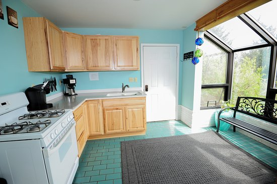 Kodiak, AK: Make dinner in our beautifully remodeled kitchen complete with gas stove in our sunroom/kitchen.