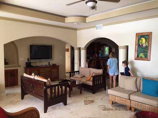 Belizean Cove Estates: Living room., with the kitchen in the background.